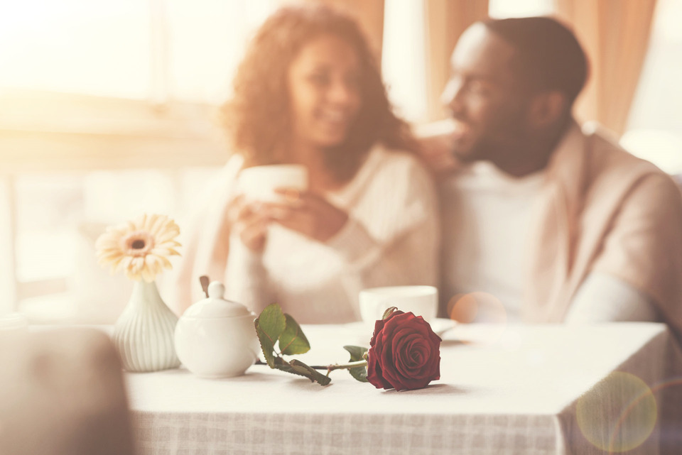 an interracial couple having coffee