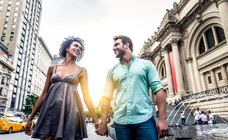 interracial couple walking in the city